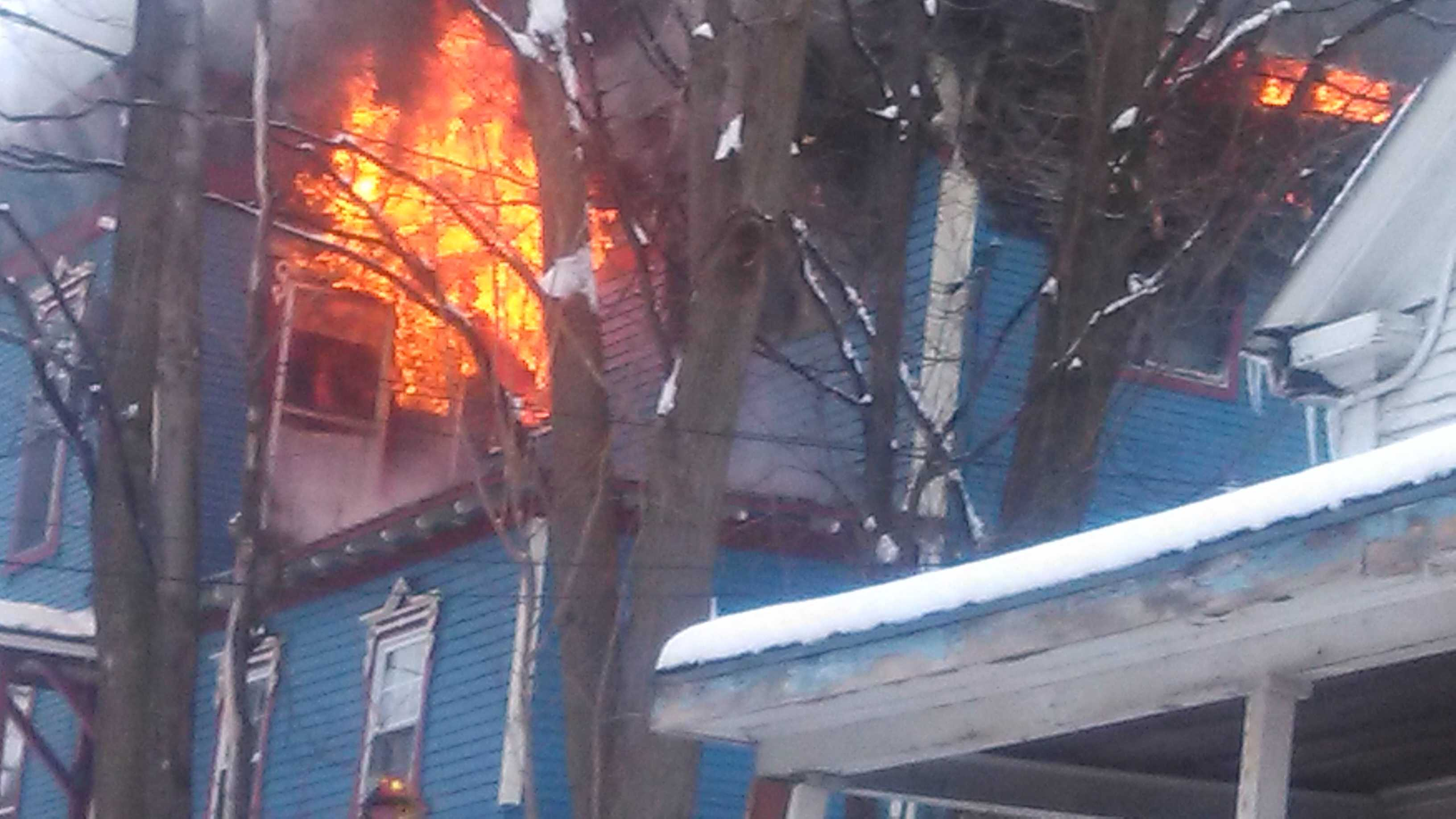 Fire at a four-apartment building on the corner of Main and Morton streets in Malone, New York.