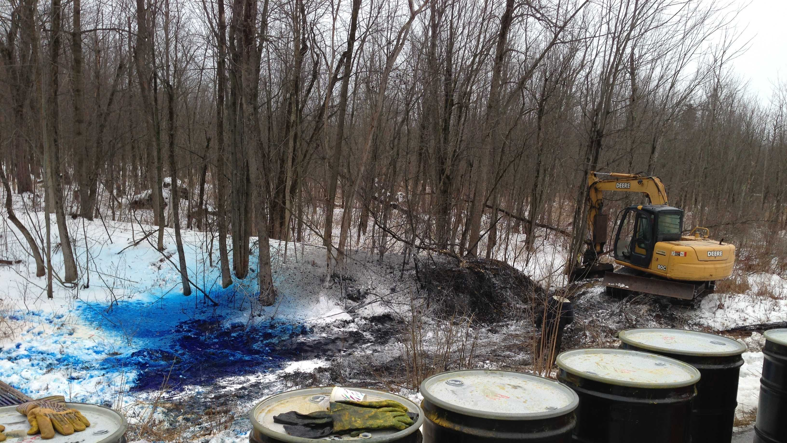 A tractor-trailer carrying barrels of black ink crash early Tuesday morning in Alburgh, Vt. Authorities believe the driver hit black ice.