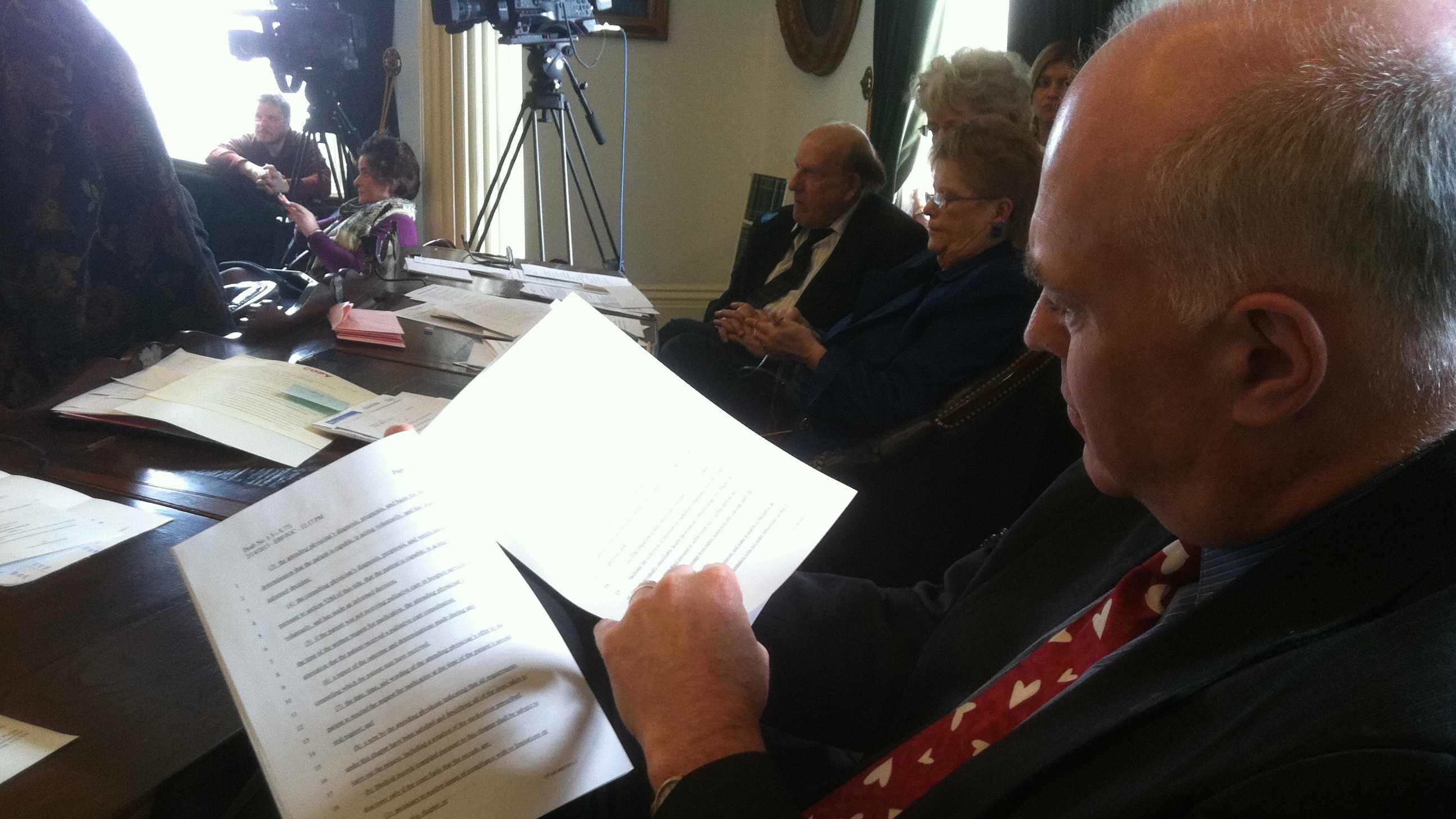 Sen. Joe Benning of Caledonia County reads through an amendment offered during Thursday's debate over end of life legislation.