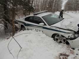 A road covered in snow and ice led to the demise of a police cruiser in Williston.