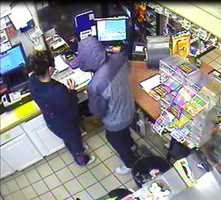 The suspect in the South Burlington Champlain Farms robbery has his back to the camera.