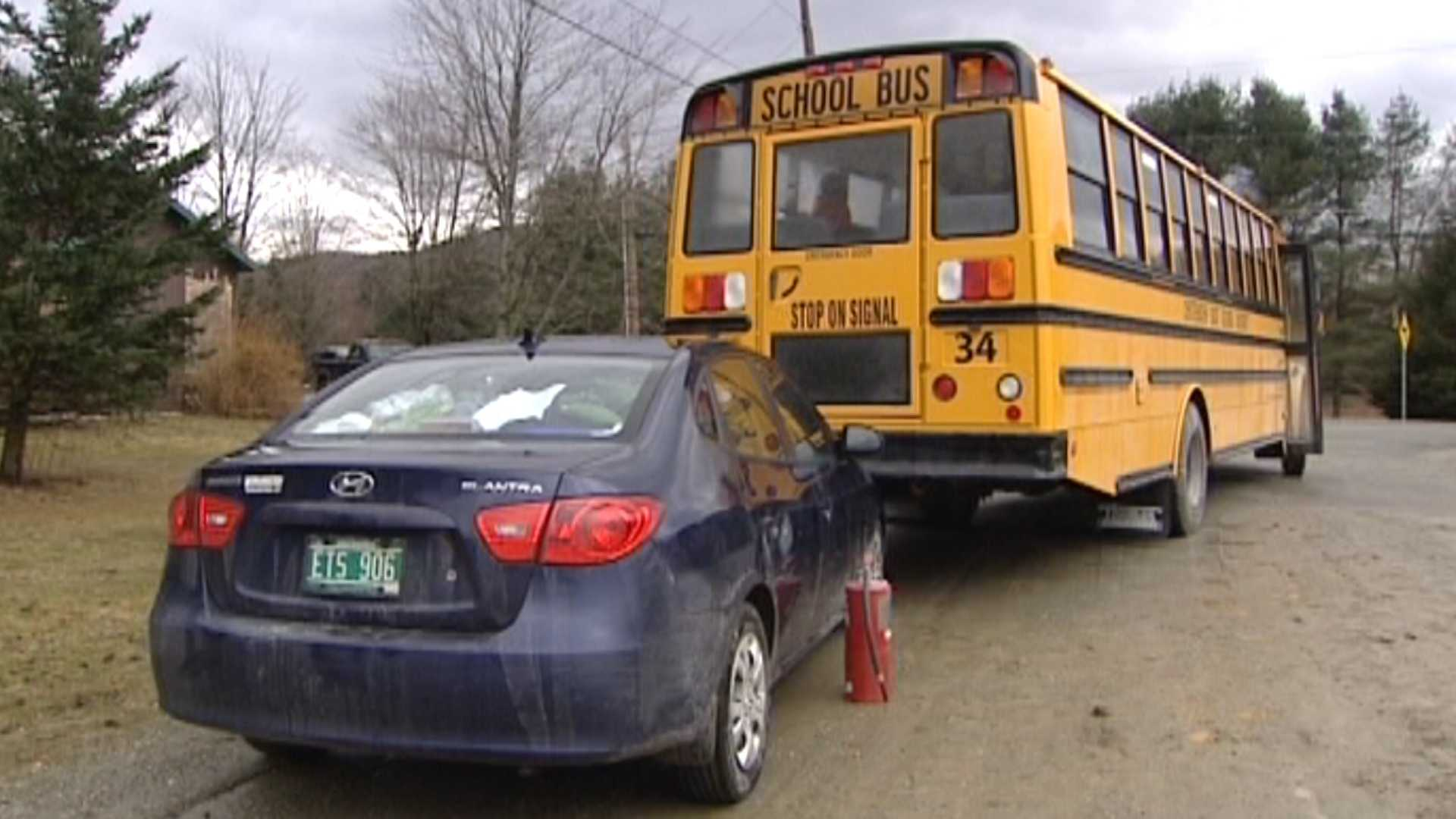 04-01-13 Police: Bus rolls into parked car - img
