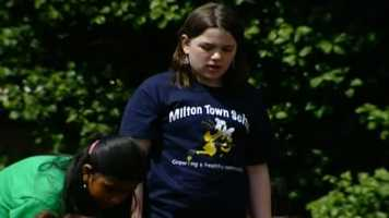 Fifth-grader Hannah Svenson takes a look at the garden.