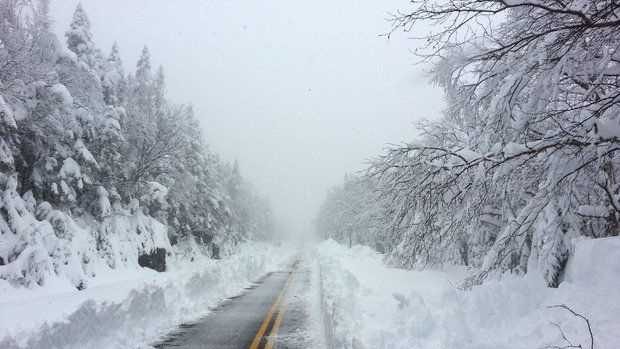 This photo provided courtesy of ORDA/Whiteface shows Whiteface Mountain Veterans' Memorial Highway after a heavy snowfall Sunday, May 26, 2013. The late-May storm has dropped 3 feet of snow on the New York ski mountain near the Vermont boarder.