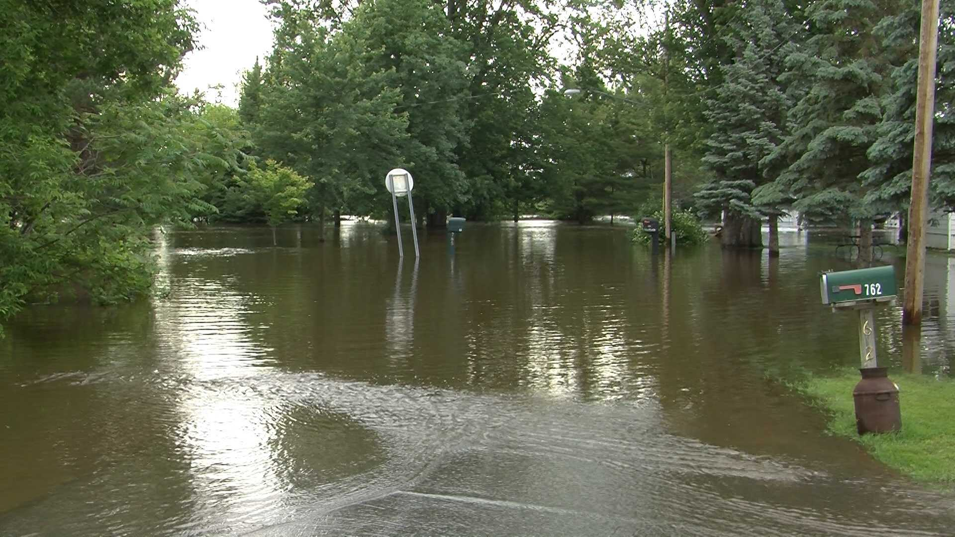 06-12-13 At least 3 rescued, neighborhoods flooded - img