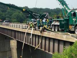 Crews are working to clean up the scene of Monday night's tractor trailer crash along the Winooski River Bridge on Interstate 89 near Exit 15.