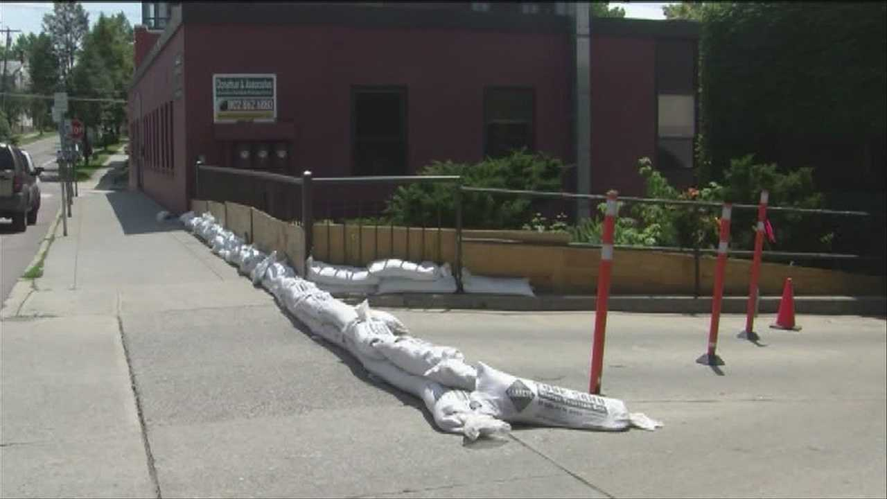 Sandbags and debris could be found along the streets of Burlington on Sunday, as the city dried out from the week's downpours. Roads in Williston remain a work in progress.