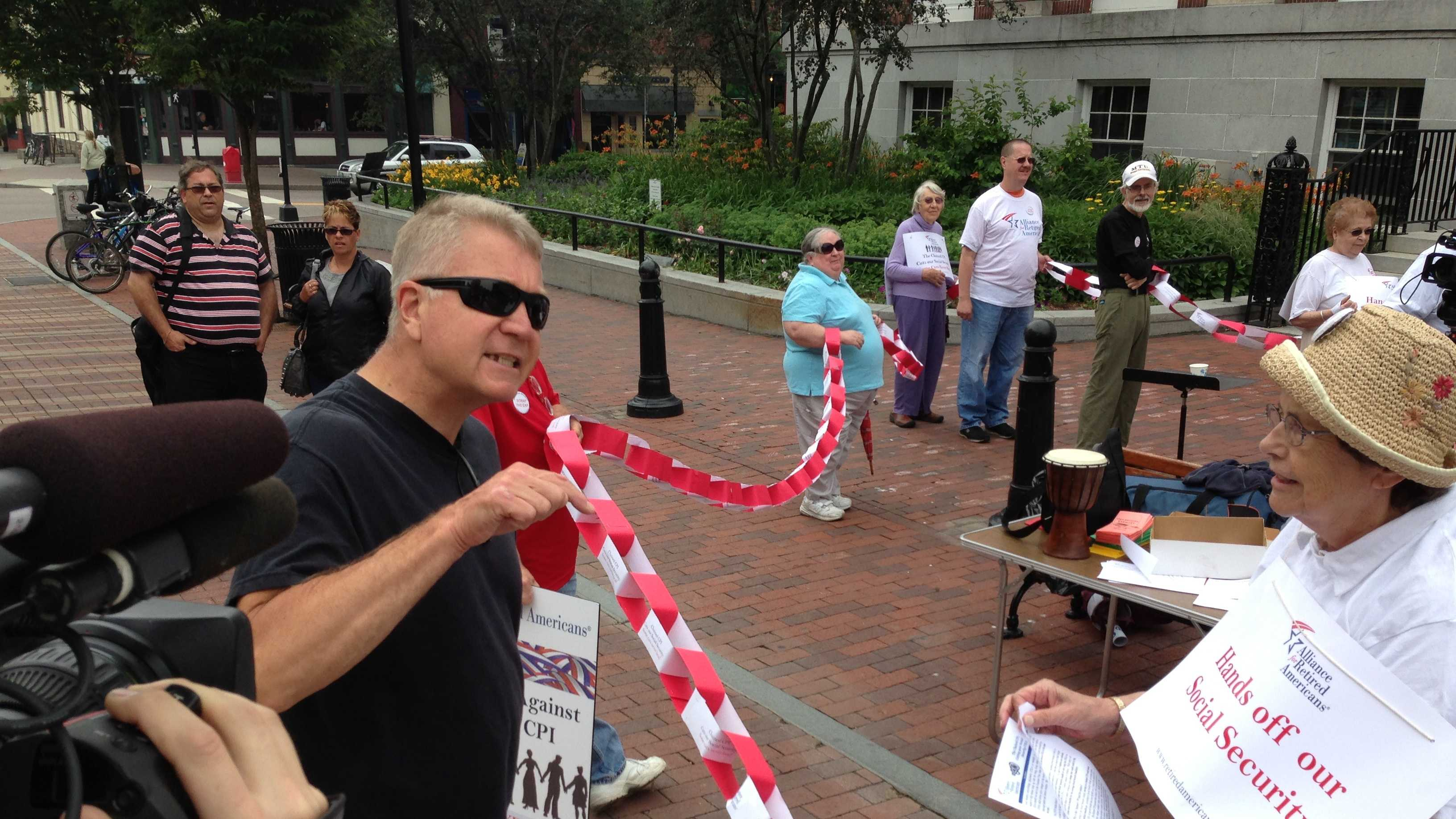 An unidentified man confronts seniors staging a demonstration against social security reform at Burlington City Hall.