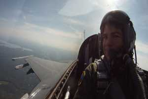 Flying in an F-16 with the Vermont Air National Guard. Yes, he threw up, but he never passed out - even under 9 Gs....
