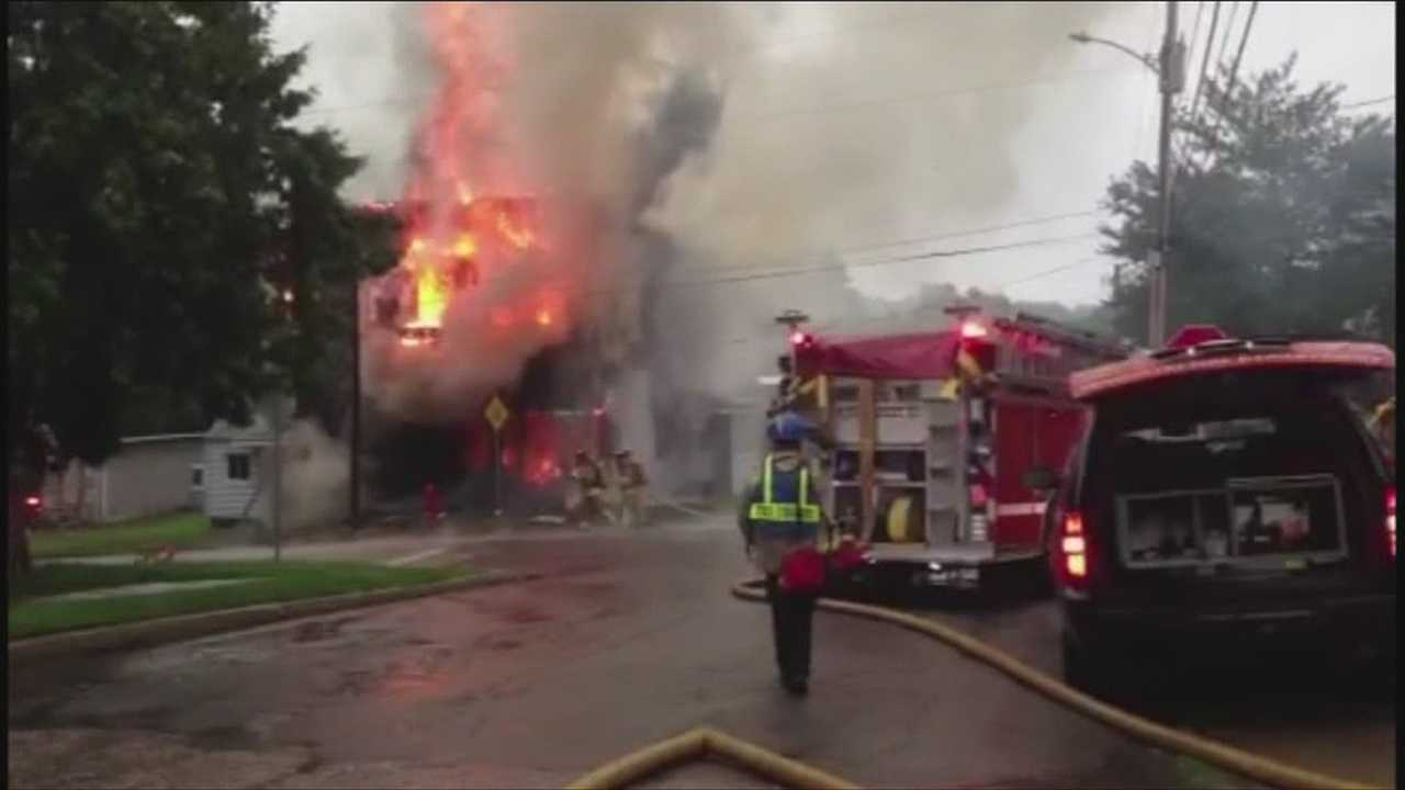 Structure collapses under flames