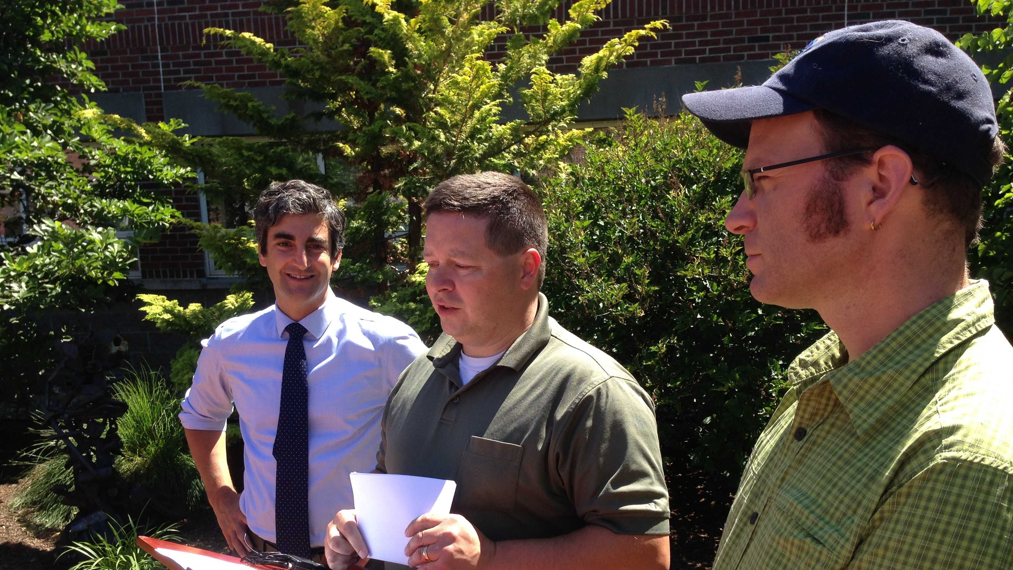 Burlington city engineer-designate Norm Baldwin speaks at a news conference Monday, with Mayor Miro Weinberger and new DPW director Chapin Spencer, right, looking on.