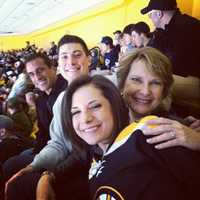 I'm a fan of all New England sports, but my main team is the Bruins. Here's shot of my parents, my brother and I in the nosebleed section of the TD Garden, where the real fans sit.