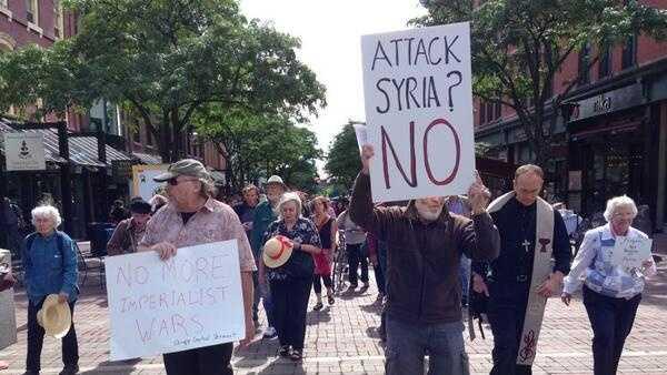 09-05-13 Opponents of U.S. strike on Syria rally - img