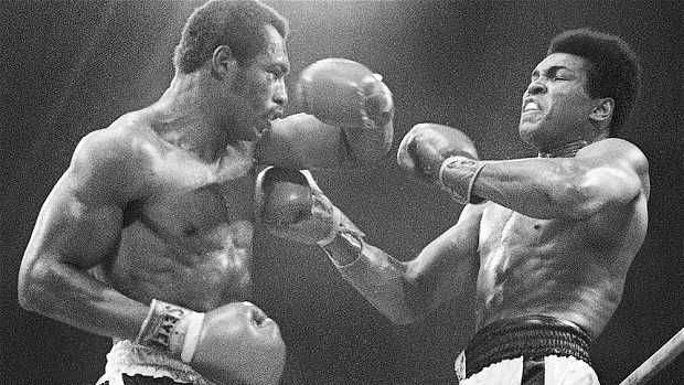 Ken Norton battles Muhammad Ali in the first of their three bouts. Norton won the first bout and broke Ali's jaw.