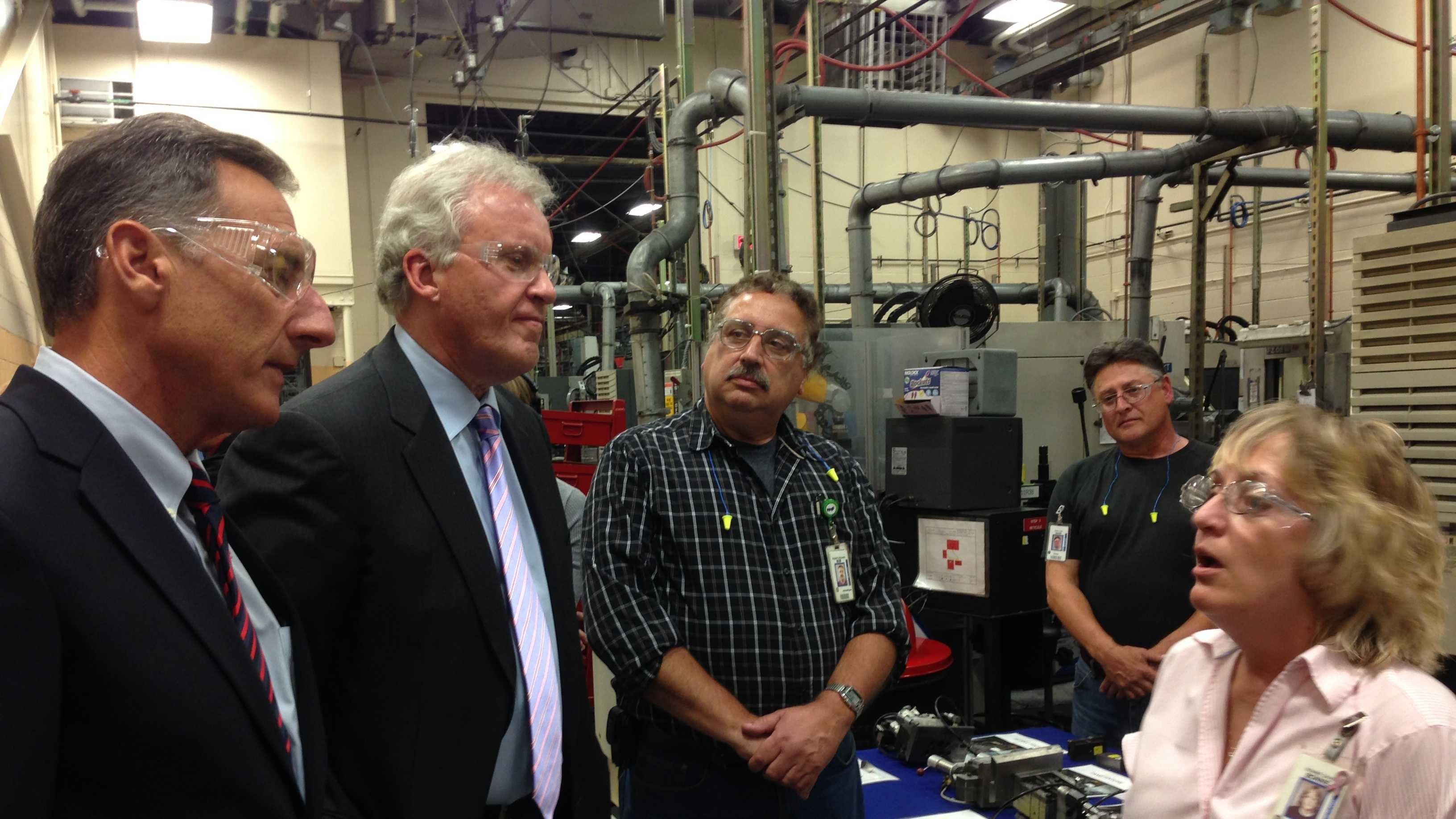 General Electric CEO Jeff Immelt, second from left, listens to plant employee Bonnie Davis in Rutland Wednesday.