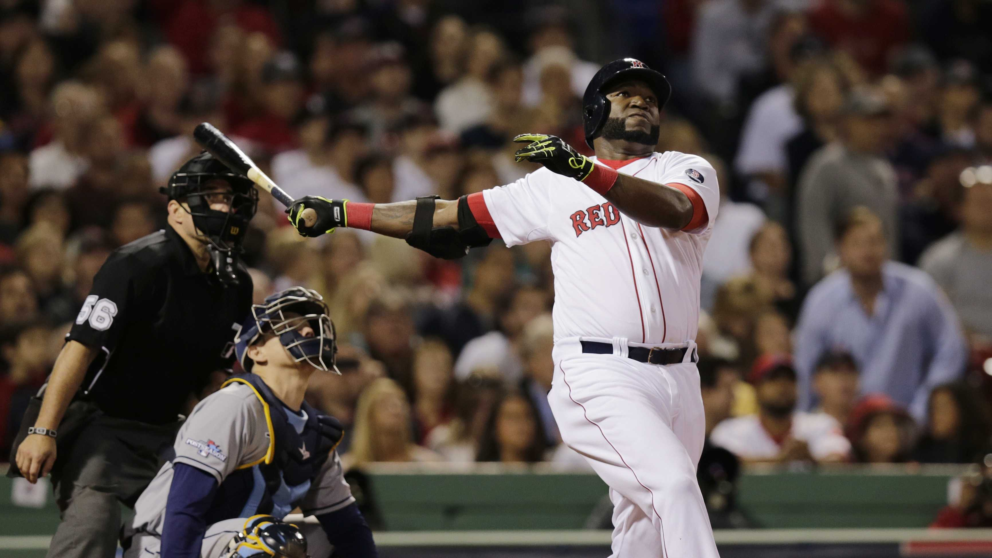 Boston Red Sox designated hitter David Ortiz watches his second home run of the game off Tampa Bay Rays starting pitcher David Price, in front of Rays catcher Jose Molina in the eighth inning in Game 2 of baseball's American League division series, Oct. 5, 2013, in Boston.
