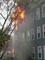 Firefighters battled a three-alarm blaze on Elliot Street in Brattleboro on Wednesday evening, officials said.