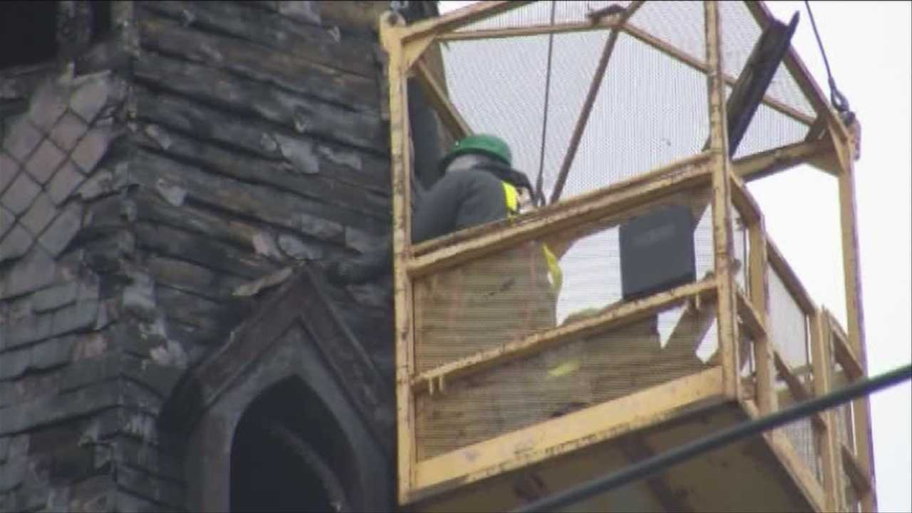 Bell tower burned in fire comes down