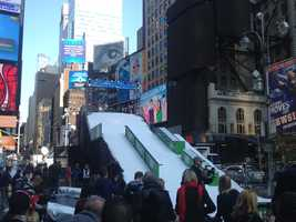 Slopes, complete with snow, were erected in Times Square as NBC counts down to the 2014 Olympics in Sochi, Russia.