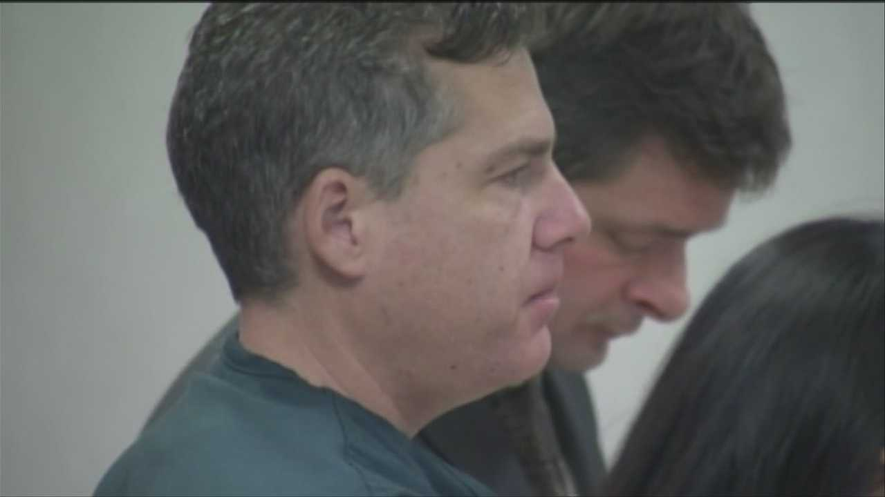 A man accused of trying to kill his wife answers a new charge in court.