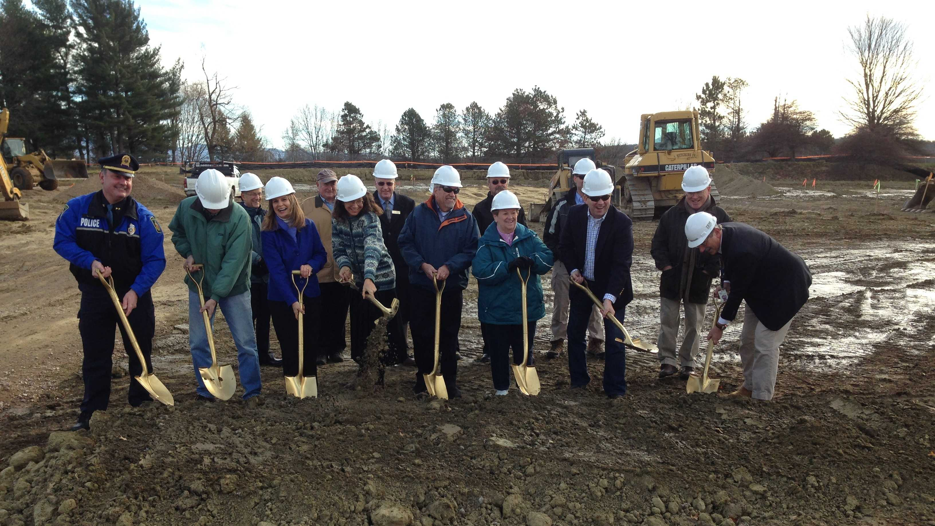 Essex leaders join Chief Brad Larose, left, for a ceremonial groundbreaking for a new police headquarters.