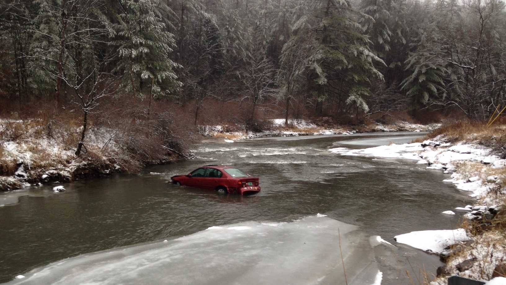 Driver crashes through guardrail, lands in river 11-27 - IMG