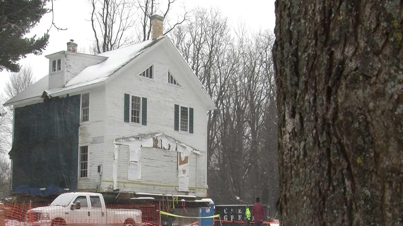 Amid snow and ice, crews move historical house