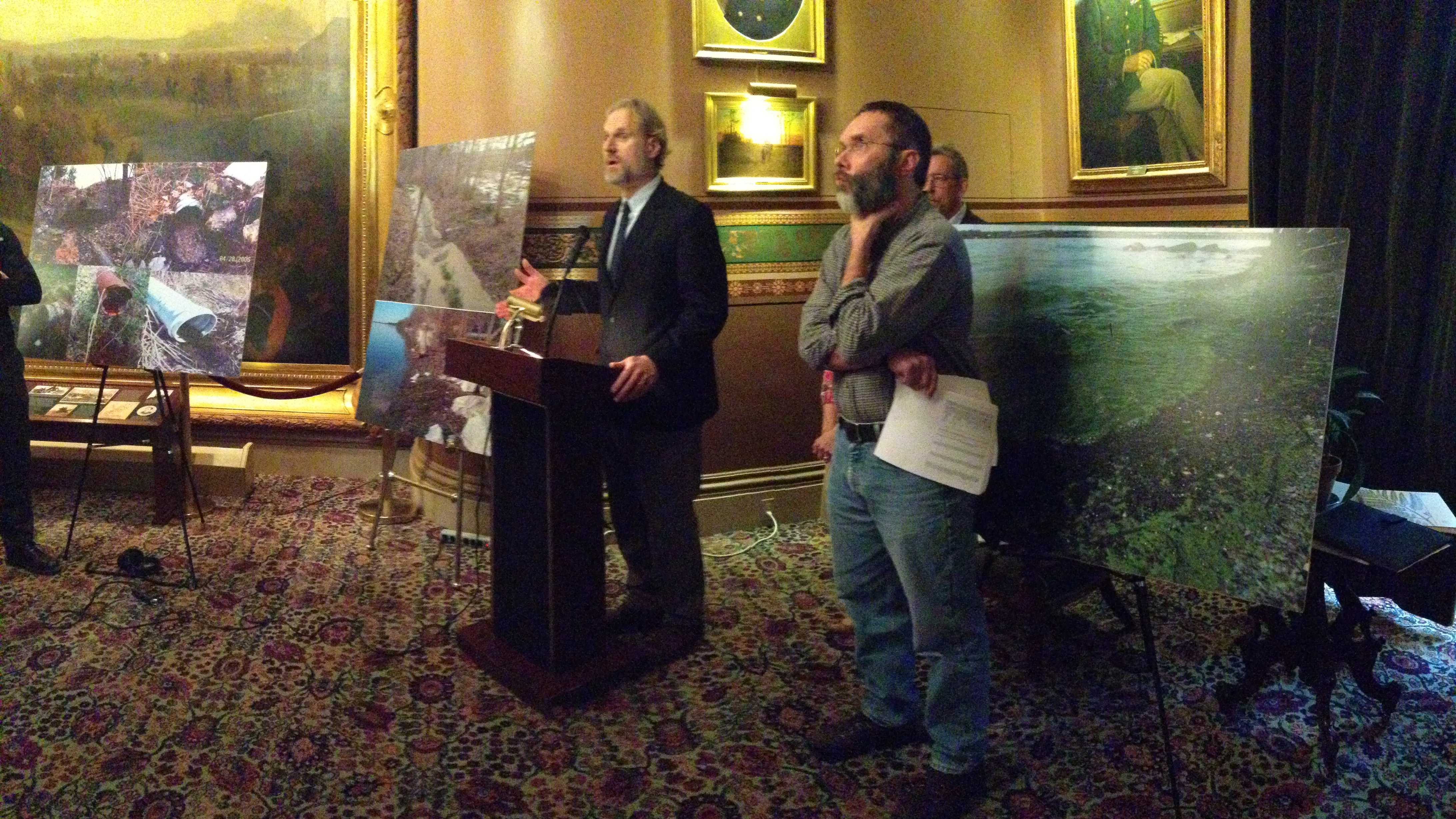 Environmental groups, including Chris Kilian of Conservation Law Foundation, at a Statehouse news conference Wednesday.