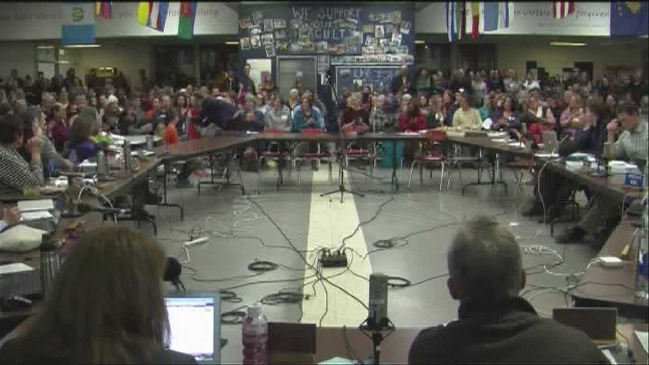 Hundreds weigh potential budget cuts at packed school meeting