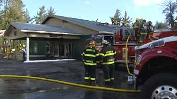 Firefighters battled flames and smoke at the Rainbow Wedding and Banquet Hall's Gold Room on Sunday, April 6, 2014.