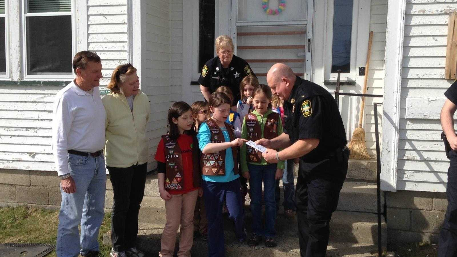 4-17-14 Girl Scouts donate to fallen deputy's fund - img