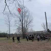 Pilot caught in tree after parachuting out of a small plane before it crash on Interstate 89N in Highgate, Vt.
