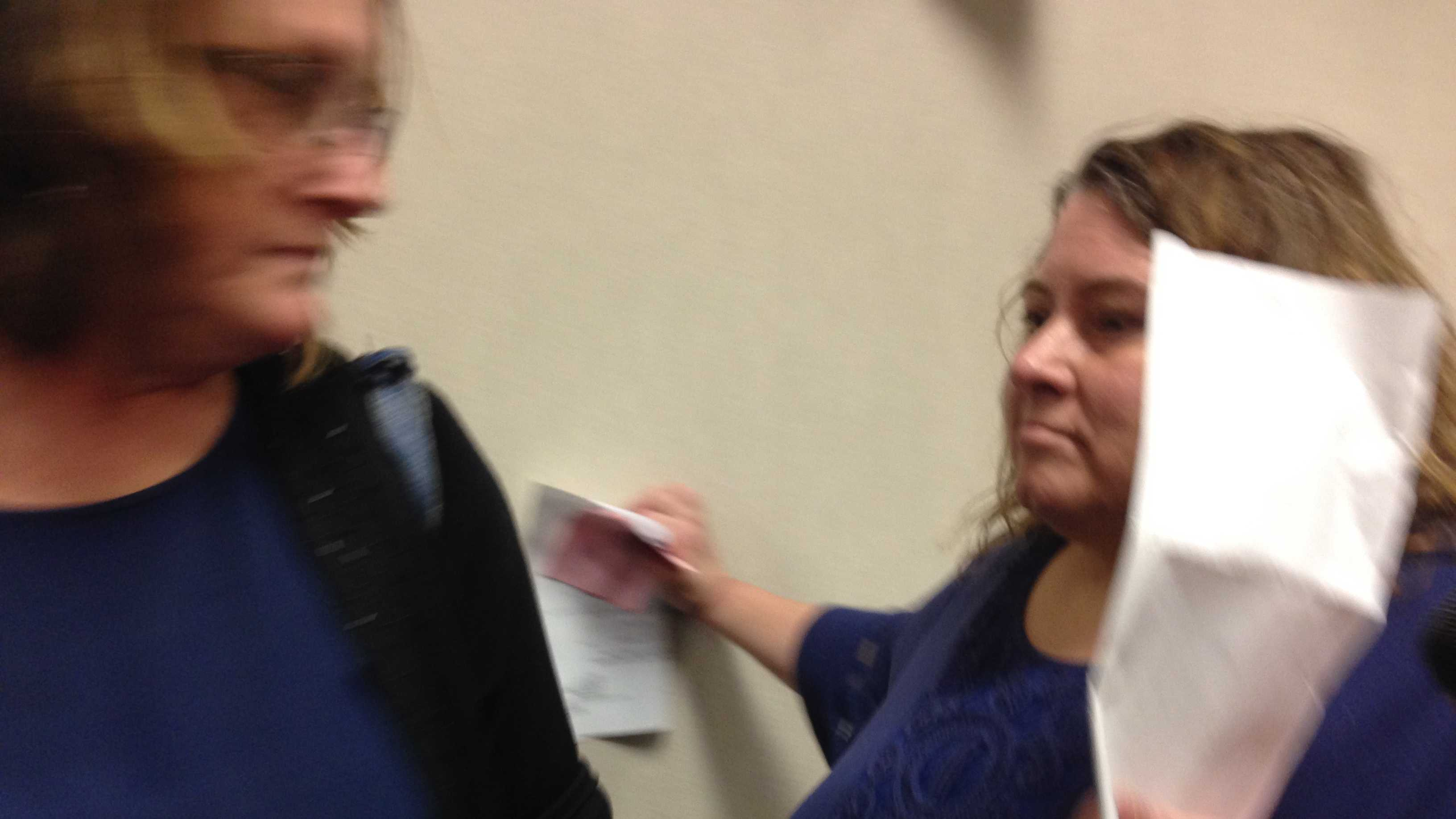 Lisa Peduzzi is seen leaving Chittenden County Court after pleading not guilty to 6 counts of theft of taxpayer money.