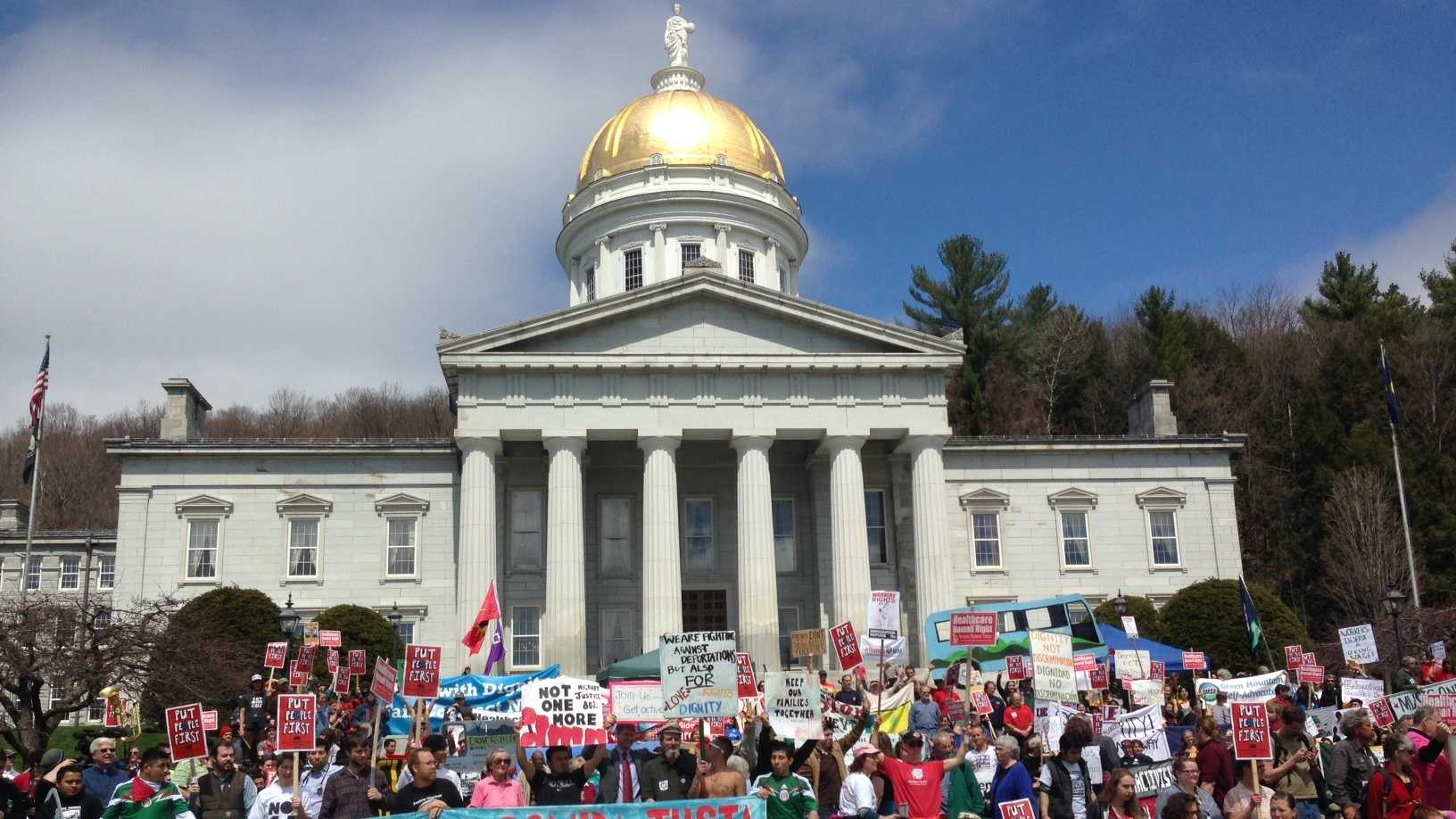 Hundreds of labor activists marched through Montpelier to the Statehouse Thursday to press for action on a range of legislation.