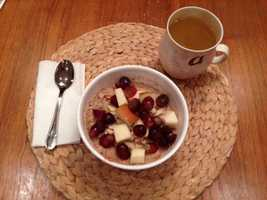 Hot oat bran cereal cooked with almond milk, pear and cinnamon and topped with more pear, red grapes and slivered almonds with a green tea. - Alison Carey, reporter