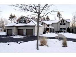 The property also includes an attached three-car garage, a detached three-car garage and an equipment shed.