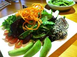 This is a salad with mixed seaweed, edamame, avocado, seared tuna and sesame ginger dressing from Asiana House in Burlington. I also ordered salmon avocado maki. I love sushi! - Courtney Kabot, anchor