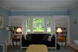 Custom bookcase units on either side of the bay window.