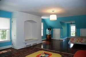The finished attic offers flexible bedroom/playroom space.