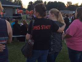 Sharing a hug and support at a candlelight vigil for two Plattsburgh High School students. One drowned in the AuSable River, the other is still missing.