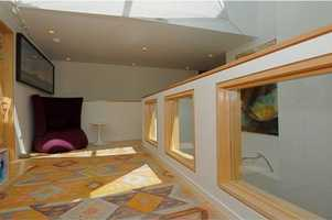 Even a sun deck has been included to make this cozy entertainment suite more interesting.