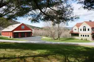 The 50'x90' five-bay barn includes radiant heat, finished space upstairs, a bath, and its own generator.