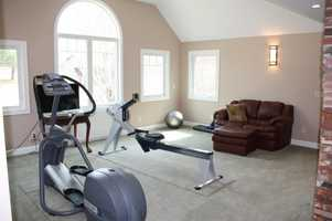 The well-lit gym could be converted to a fifth bedroom if needed.