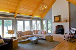 Stunning family room with vaulted ceilings, plastered gas fireplace & stainless built-ins opens to gorgeous views and a deck overlooking your 335 feet of lakeshore.