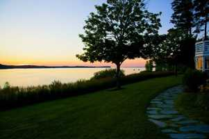 Clean, beautiful lake frontage with 50 ft dock w/ lift on desirable Shelburne Bay.