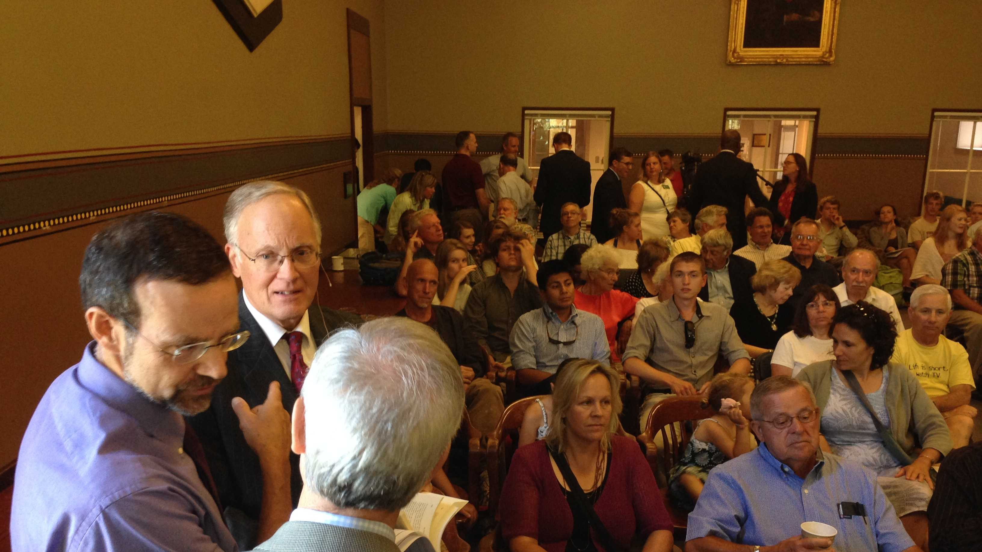 Former governor Jim Douglas prepares to address a crowd at UVM gathered for the release of his new memoir.