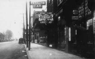 """The Forbes Avenue retail area looking east from Murray Avenue to Shady Avenue in 1930. The older images in this slide show are from the book """"Squirrel Hill"""" prepared by the Squirrel Hill Historical Society and published by Arcadia Publishing. The full book may be purchased through Arcadia on their website."""