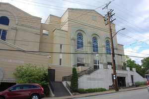 A fire damaged the building in the late 1990s. Since then, Beth Shalom has expanded even more, and makes up a sizeable portion of the block.