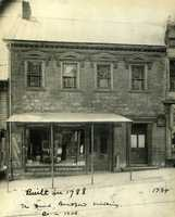 Here's a picture of Bradford's home along South Main Street. The Bradford House was built by David Bradford in 1788. During its history, it has been a dry-goods store, an undertakers office, furniture store, bakery, grocery store and fruit stand. This images shows it as Washington Furniture Company and Undertaking.