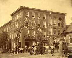 Built in 1818 as the Morrow House, in 1880 the fourth floor and a three story addition were built and it was renamed the Auld House and later the Auld Hotel. On December 23, 1963 the hotel caught fire and burned to the ground. - Corner of Main and Maiden